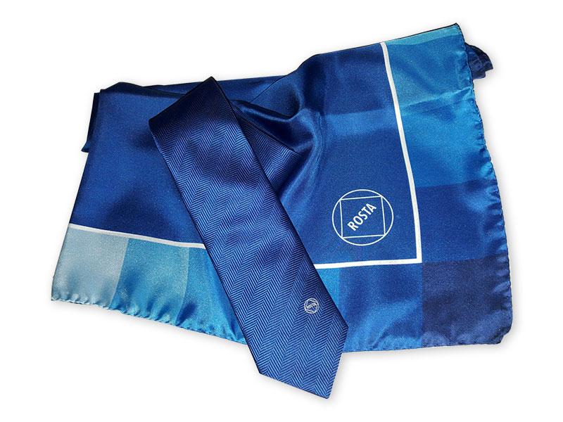 Für unseren Kunden Rosta Seidenkrawatten mit platziert eingewobenem Logo, dazu passende Seidentücher im Corporate Design